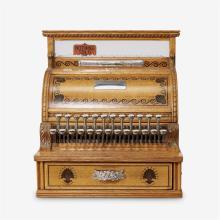 An American ebony-inlaid tiger oak cash register, National Cash Register Co., Dayton, Ohio, circa 1891