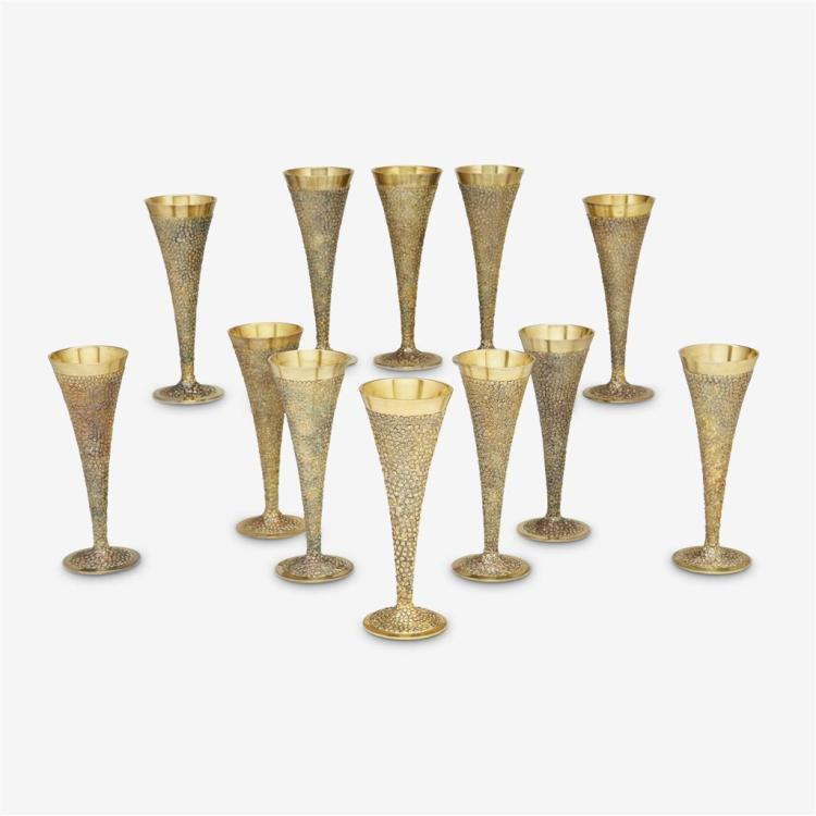 Twelve small Elizabeth II silver-gilt pebbled champagne flutes, Stuart Devlin, London, 1968-69