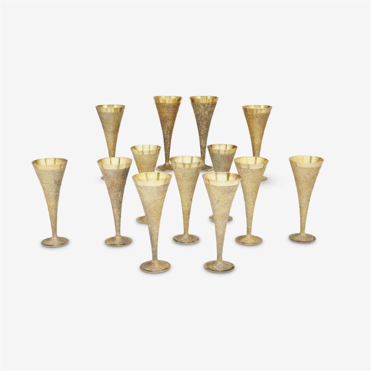 Thirteen large Elizabeth II silver-gilt pebbled champagne flutes, Stuart Devlin, London, 1968-69