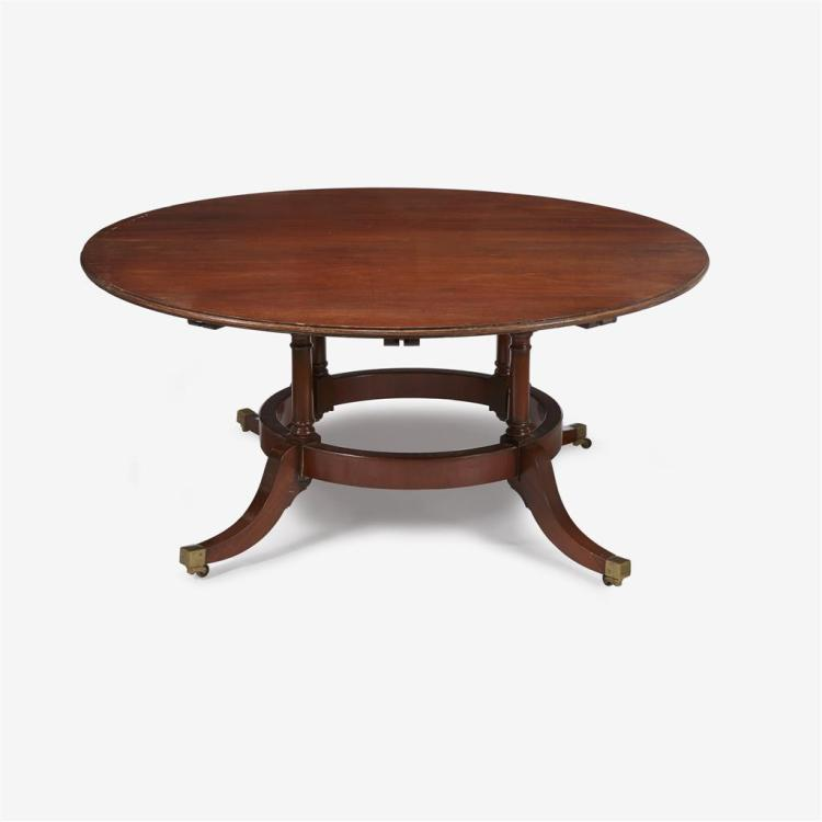 A Regency style mahogany extending circular dining table, 20th century