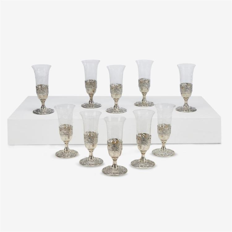 A set of ten classical style pierced and repoussed sterling silver and etched glass champagne flutes, Bailey, Banks & Biddle, Philad...