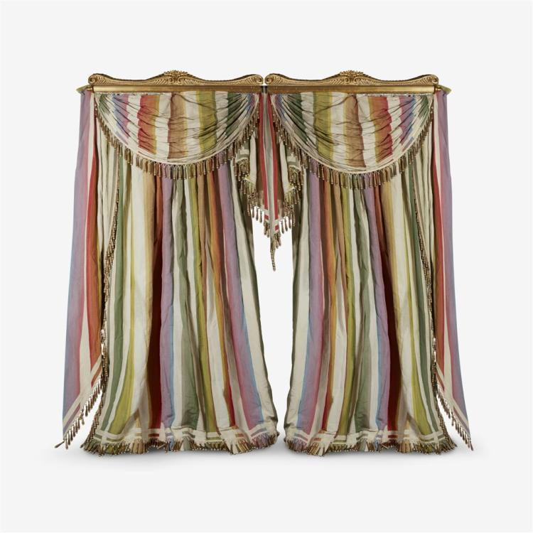 A pair of draped, swagged, and tasseled striped silk curtains, Designed by Mario Buatta (1935- )