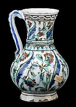 Fine Iznik pottery jug, ottoman turkey, circa 1590, Baluster form, painted with a pattern of alternating saz leaves and roses in green,