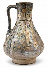 Large Raqqa pottery ewer, syria, 13th century, Pear-shape body decorated with foliage bands in turquoise, cobalt blue and black on a wh