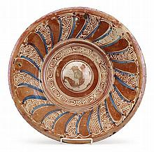 Hispano Moresque lustreware charger, possibly valencia, 16th century, The tin-glazed earthenware charger with copper lustre, the raised