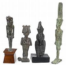Four Egyptian bronze figures, third intermediate to ptolemaic period, 1069-30 b.c., Depicting Nefertum, Osiris, Atum, and Amun, two on