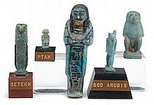 Five Egyptian faience figures and amulets, third intermediate period to ptolemaic period, 1069-30 b.c., Depicting a Shabti, Thoth, Babi