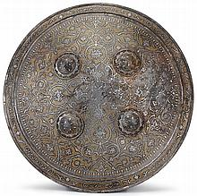 Qajar silver and gold-damascened shield, iran, 19th century, Circular dished form with four bosses applied to center, decorated overall