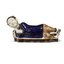 A Chinese painted ''reclining lady'' ceramic pillow, qing dynasty