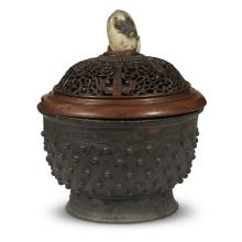 A Chinese archaistic bronze vessel with carved wood cover, jade finial,