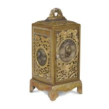 A small Japanese mixed metal and gilt bronze minature cabinet, meiji period, late 19th century