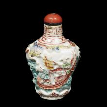 A Chinese Canton enameled and molded porcelain snuff bottle,