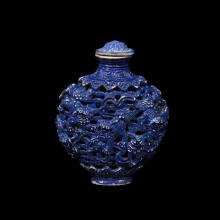 A Chinese blue glazed molded porcelain ''lions'' snuff bottle,