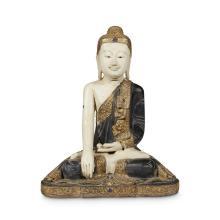 A Burmese style painted wood figure of a seated Buddha,