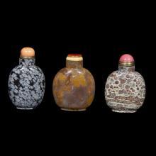 Three Chinese hardstone snuff bottles,