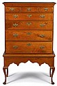 Queen Anne walnut chest-on-frame, pennsylvania, mid 18th century, Flat cove molded top with three small and four graduated wide drawers