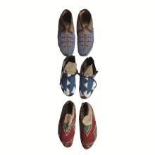 Three pairs of Sioux beaded hide moccasins, Early 20th century