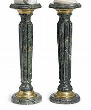 Pair of gilt metal green marble pedestals, 20th century, The circular top with molded edge raised on reeded tapering column and circula