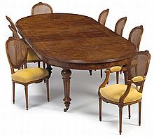 French marquetry inlaid walnut extending dining table and eight dining chairs, 20th century, The oval top with marquetry inlay of fans