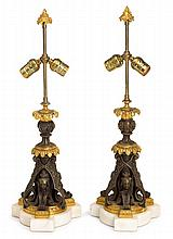 Pair of Napoleon III gilt and patinated bronze candlesticks, third quarter 19th century, Mounted as lamps, the acanthus candlecup above
