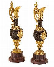 Pair of French Renaissance revival gilt and patinated bronze ewers, 20th century, The tall baluster form ewer with caryatid mounted scr
