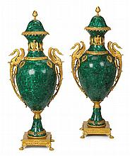 Pair of large Napoleonic style malachite veneered and gilt bronze mounted covered urns, 20th century, The domed cover with pinecone fin