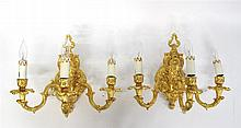 Pair of Louis XV style gilt metal three-arm wall sconces, 20th century, The scroll and cartouche cast backplate issuing three foliate