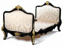Louis XV style gilt mounted ebonized oak daybed, 20th century, The head and foot board fully-upholstered to both sides within arched fr