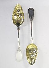 Pair of Victorian silver serving spoons, john walton, newcastle, 1839-61, With gilt-washed repoussé and chased berries to bowl, handle