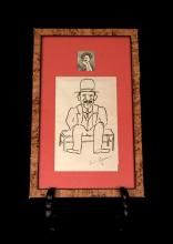 (Autographs : Artists). Caruso, Enrico. 1 Piece. Original pen and ink drawing signed. Caricature of seated, hat-wearing, mustachioed...