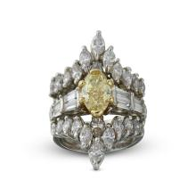 A fancy intense yellow diamond and platinum ring,
