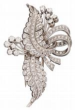 A diamond and platinum brooch, , designed as foliate and ribbon motif, enhanced by pavé-set diamonds; total diamond weight approximatel