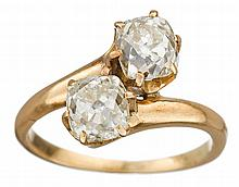 A diamond and eighteen karat gold 'moi et toi' ring, , set with two old mine-cut diamonds; diamonds weigh approximately: 0.75 carat r