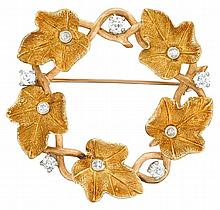 A diamond and fourteen karat gold brooch, , designed as a wreath of leaves accented by circular-cut diamonds; total diamond weight appr