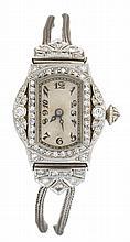 A diamond and platinum wristwatch, early twentieth century, tonneau shape dial with Arabic numerals, single-cut diamond bezel, circular