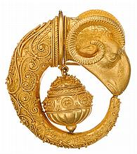 An Archaeological Revival eighteen karat gold brooch and earrings, , designed as a ram's head with granulated gold wire and bead detai