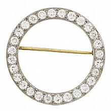 A diamond and platinum brooch, , set with circular-cut diamonds; total diamond weight approximately: 2.75 carats.