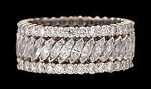 A diamond and platinum band, , set with full and marquise-cut diamonds; total diamond weight approximately: 4.60 carats.