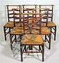 Six George III ladderback side chairs, possibly welsh, The turned top rail over turned supports flanking ladder splat, the rush seat ov