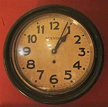 Ebonized circular railway station clock, india, circa 1900, the dial marked scientific clock mfg co., The white painted tin dial with A