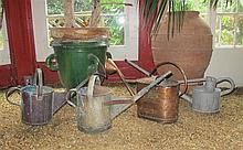 Group of four copper, brass, iron and zinc watering cans, , Of cylindrical or oblong shape with loop handles and extended spouts, the c