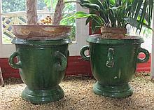 Pair of green glazed terracotta garden urns, probaly northern european, Campagna form with four loop handles, interior unglazed.
