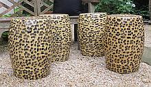 Four Chinese style porcelain garden seats, 20th century, Drum form, glazed in imitation of leopard fur with reticulated double-coin med