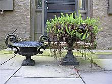 Two cast iron garden urns, late 19th/early 20th century, Both of campagna form.
