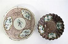 Two Italian tin-glazed earthenware manganese ground plates, 18th century, The plate with central roundel painted with eagle, the border