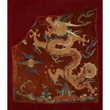 A Chinese couched gold and silk-embroidered red velvet robe fragment, late ming/early qing dynasty, 16th/17th century