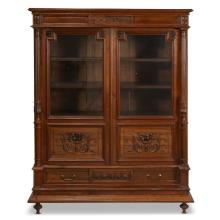 A French Louis XVI style carved mahogany bibliothèque, circa 1890