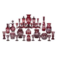 A collection of Bohemian ruby cut-glass tablewares, egermann, haida, bohemia, late 19th century