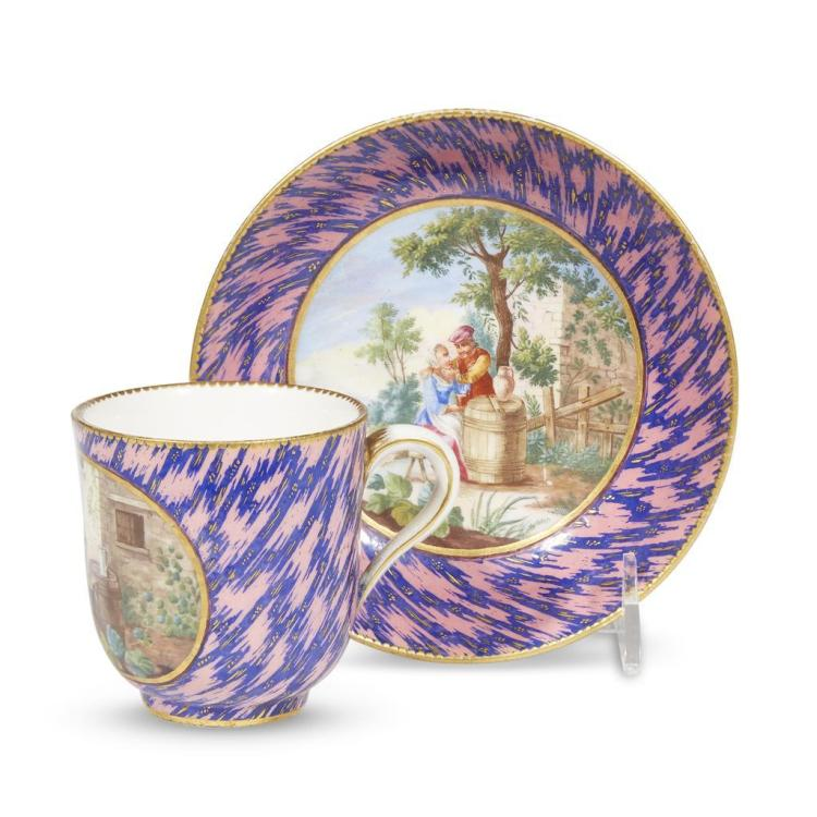 An unusual Sèvres hard-paste porcelain cup and saucer with rose Pompadour and cobalt faux-marble ground, 1770