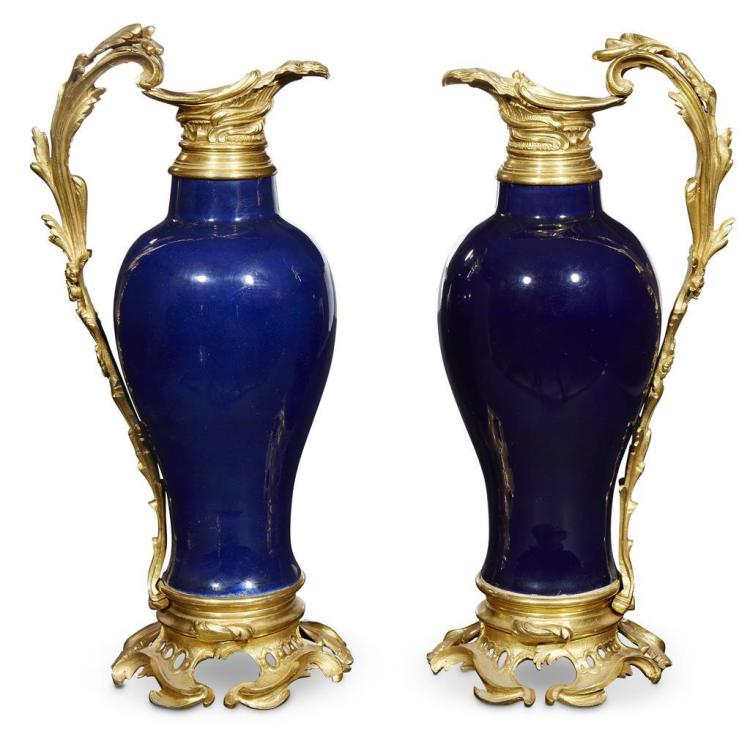 A pair of Louis XV style ormolu-mounted cobalt-glazed porcelain ewers, 19th century